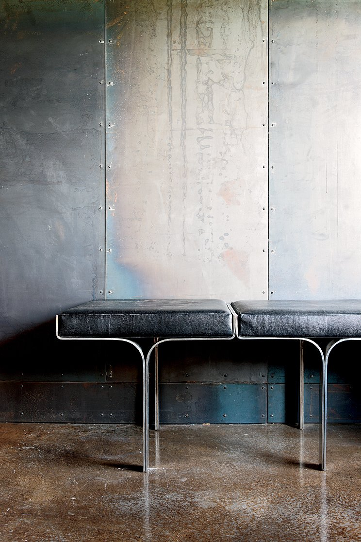 An aluminum bench harmonizes with the industrial nature of the galvanized-steel walls and the polished concrete floor. Scrap House - Photo 3 of 8