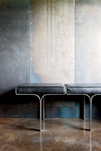 An aluminum bench harmonizes with the industrial nature of the galvanized-steel walls and the polished concrete floor.