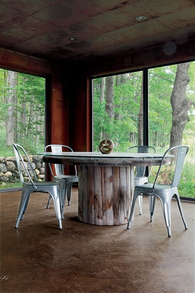 """10 Enclosed Porches That Are Put to Good Use - Photo 5 of 10 - """"Repurpose, refurbish, recycle"""" was the guiding principle for a metals broker in Ontario who harnessed his passion for–and knowledge of–industrial materials to create a new house from old scrap. Shown here is the enclosed porch."""