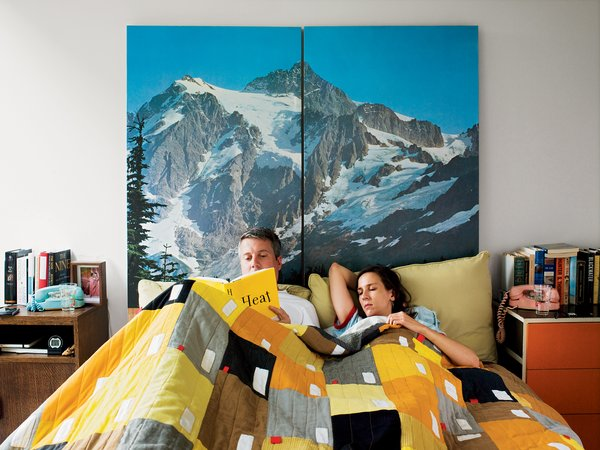 Alexandra and Barlow enjoy a leisurely Alpine morning in bed underneath a quilt by Cranbrook Academy of Art graduate Abigail Newbold.