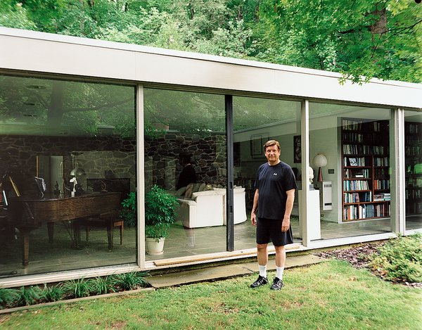North stands outside his glass-walled living room, which also houses his small library of books about Breuer.