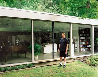 Marcel Breuer Hooper House II - Photo 3 of 9 - North stands outside his glass-walled living room, which also houses his small library of books about Breuer.