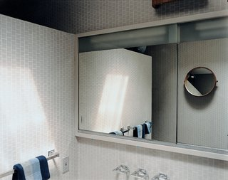 The main bathroom is a vision from the past and hasn't been updated with contemporary fixtures.