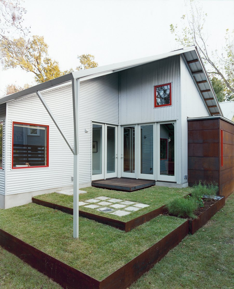 A back patio, designed by Allison's sister, Jennifer Orr, a landscape architect, opens to the living room and to the office. Double Time - Photo 7 of 7