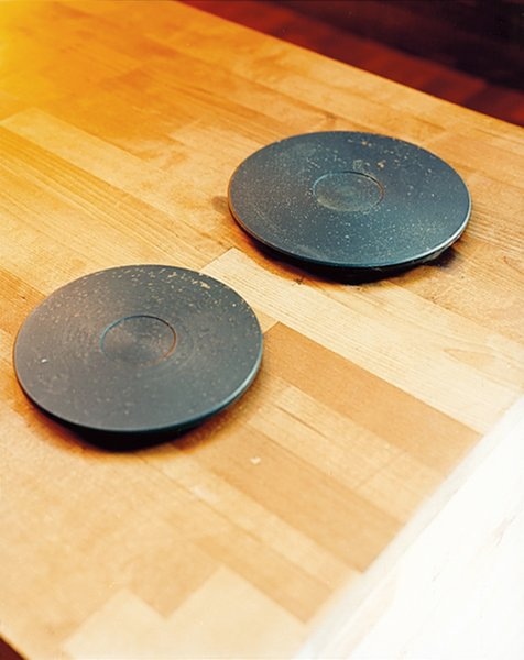 A pair of hot plates await dishes in the dining nook.
