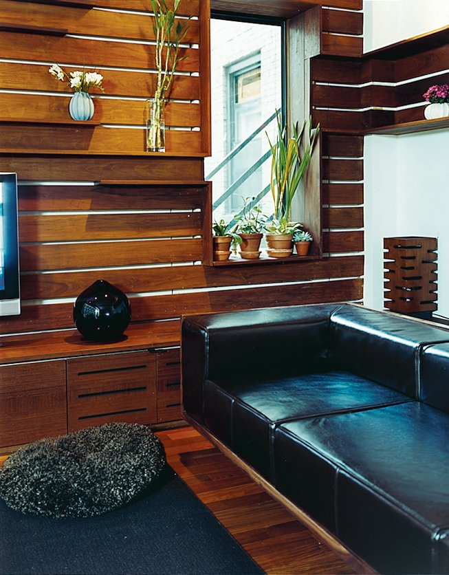 Ingenuity can compensate for a modest budget. The Zizmors removed the base from a mid-priced leather couch from West Elm and inserted it in a custom armature made with walnut veneer. Outdoor Living in NYC - Photo 11 of 11