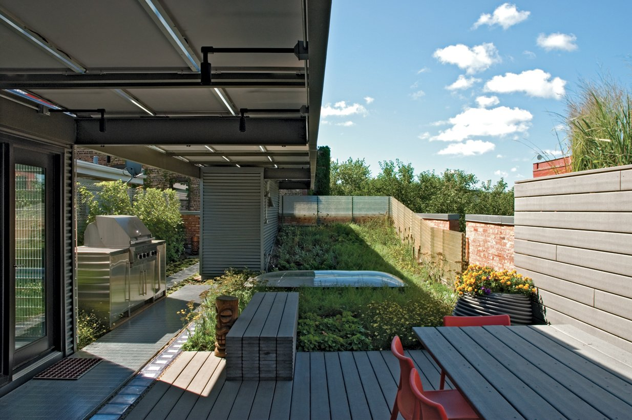 A rainwater catching system irrigates the rooftop garden, which also has a dining area and grill. Tagged: Outdoor and Wood Patio, Porch, Deck.  Photo 6 of 7 in Solid Gold