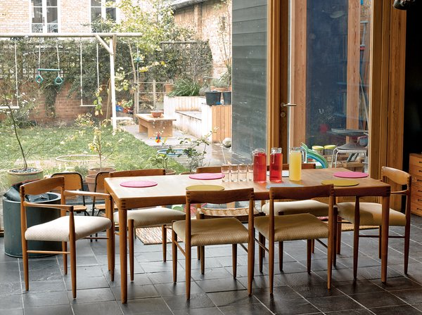 The dining area benefits from the abundant natural light that pours in from the garden.