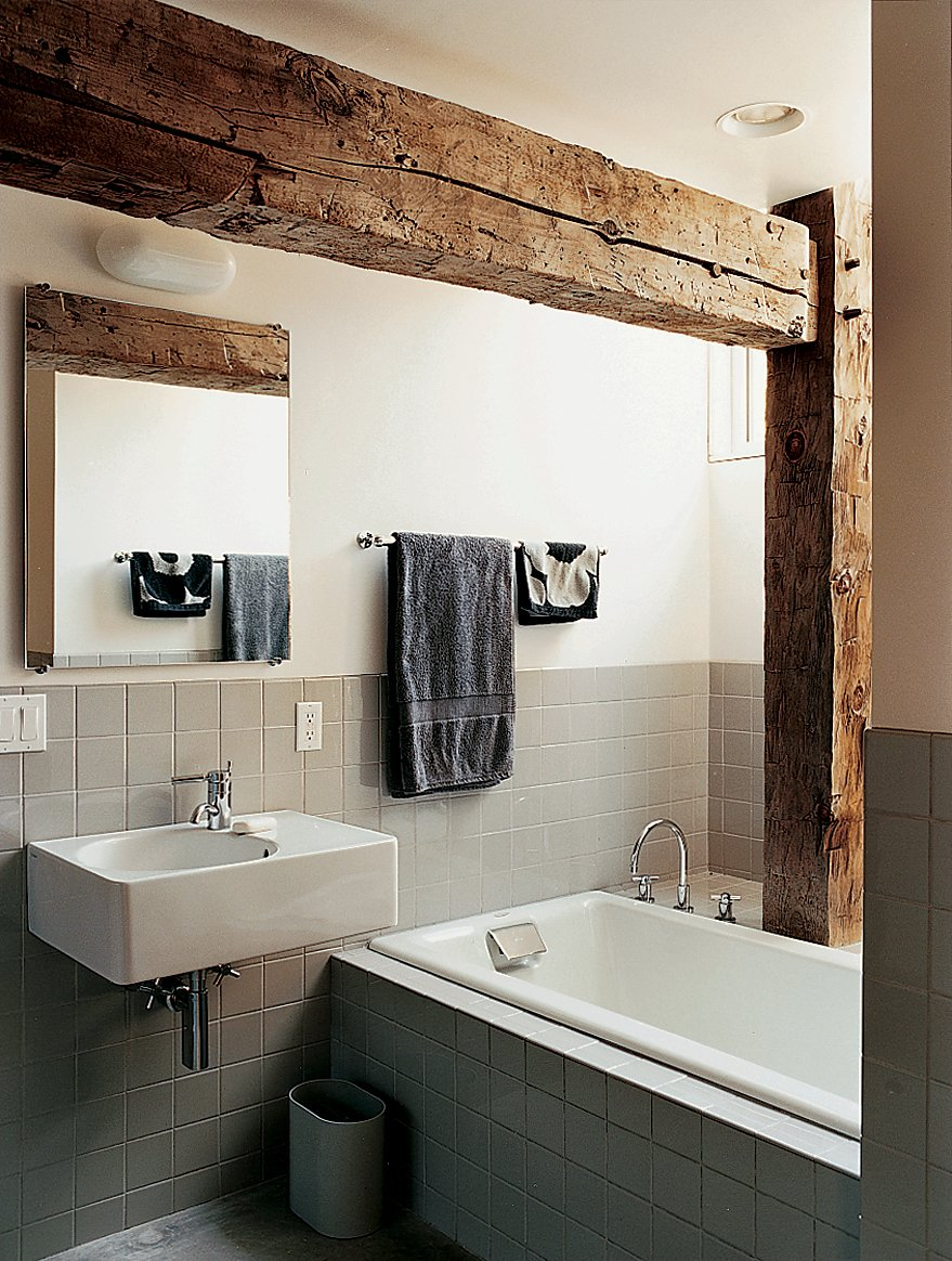 Rather than concealing the barn frame in the private rooms, Cohen created an interplay between modern and historic elements in the master bathroom.  Photo 5 of 7 in Raising the Barn