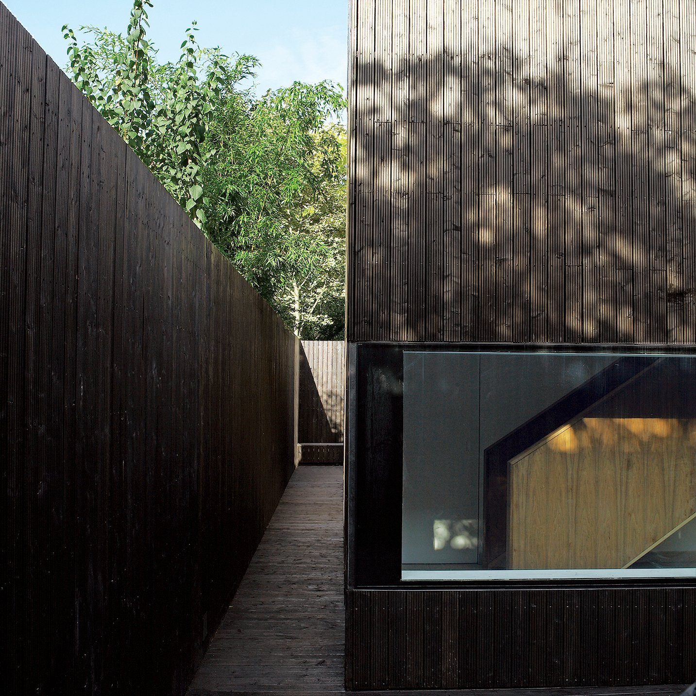 The outer walkway leads all the way around the structure, spilling into a small patio in back.  Photo 3 of 13 in All Clad