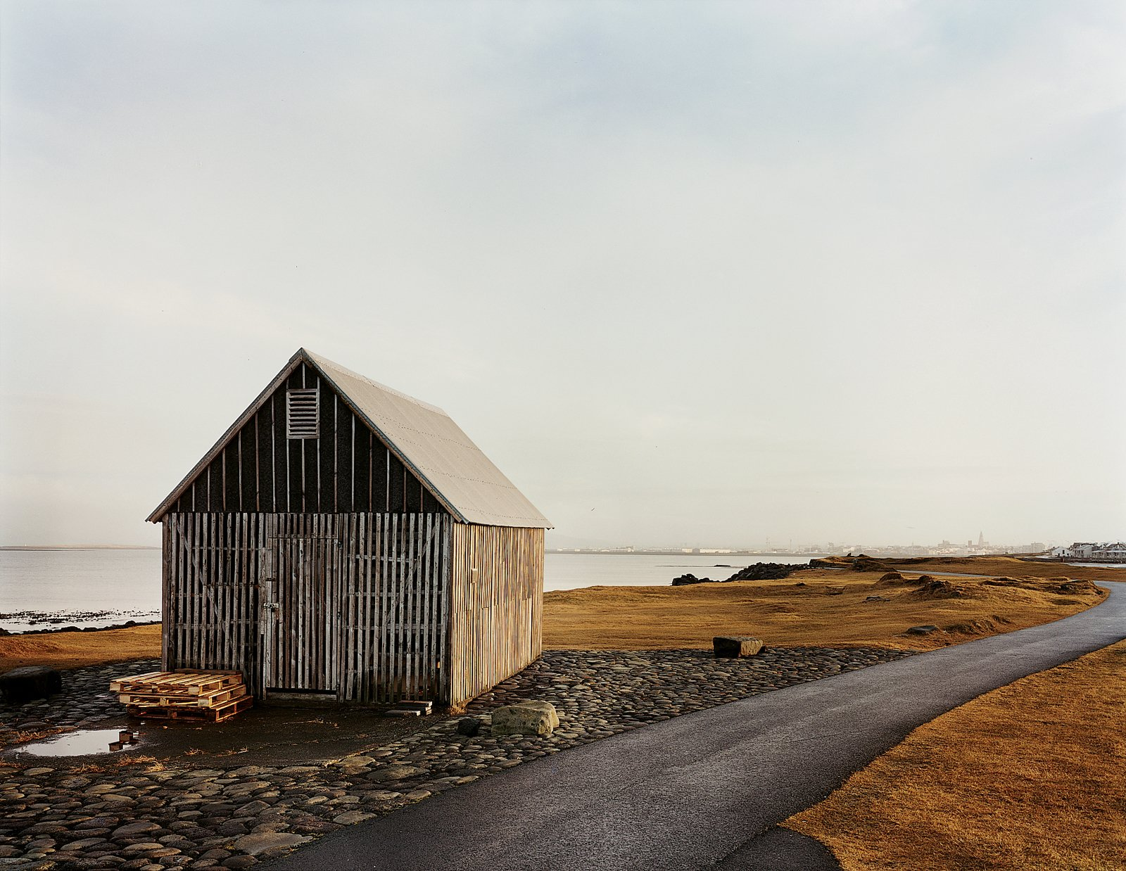 A shark-skinning shack. Tagged: Exterior, Cabin Building Type, and Wood Siding Material.  Photo 93 of 101 in 101 Best Modern Cabins from Reykjavík, Iceland