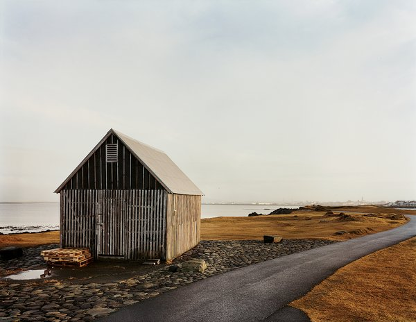 A shark-skinning shack. Tagged: Exterior, Cabin Building Type, Wood Siding Material, Gable RoofLine, and Metal Roof Material.  Photo 93 of 101 in 101 Best Modern Cabins from Reykjavík, Iceland