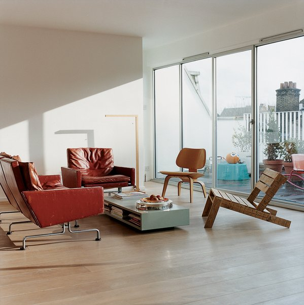 Nina Tolstrup's living space is furnished with a combination of pieces that she's designed herself, like the Pallet chair she created for the Ten, 10, X projectat 100% Design, and the classics she's collected from the likes of Kjærholm (in red leather) and Eames.