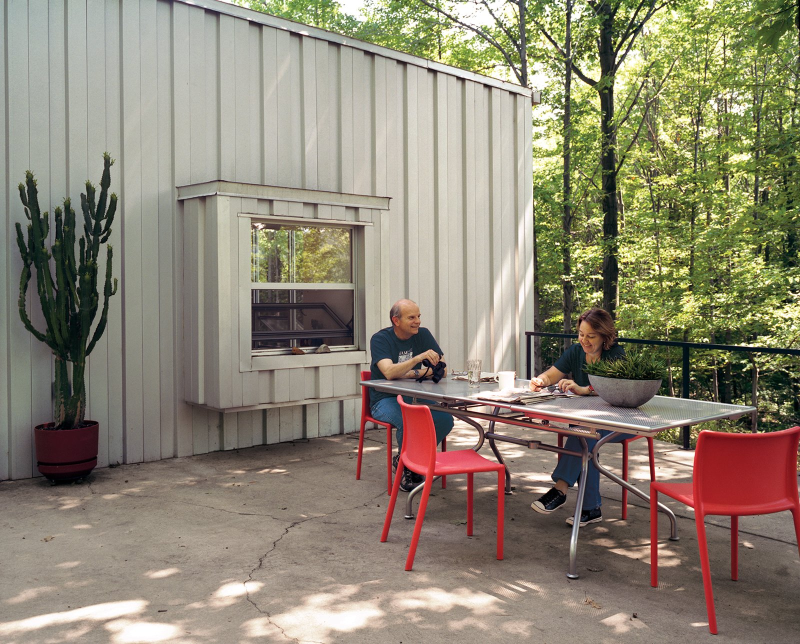 Compa and Cook relax on a patio at the western end of the house that overlooks a neighboring farm.