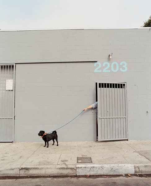 Except for adding a coat of grayish paint and stenciled numbers, Beck changed little about the building's façade.
