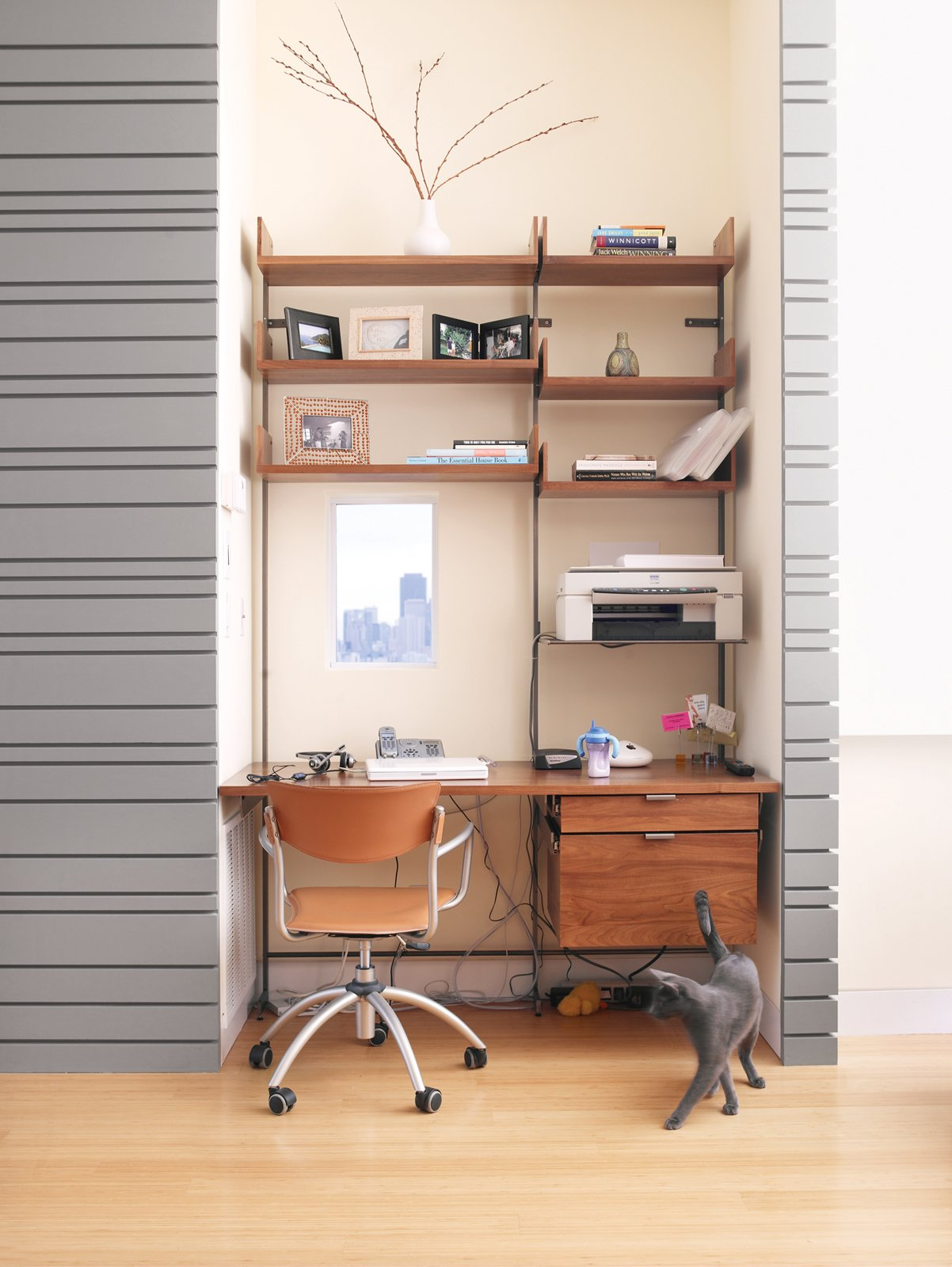 The office cubby, outfitted with a diminutive window (as per Koshkarian's request), is furnished with Atlas shelving.  Storage by Dwell from Top Notch