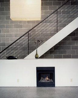Pittsburgh Steeler - Photo 2 of 5 - Still life with IKEA lampshade and ventless fireplace. The unfinished, black, welded- steel railing borders steps made of framing lumber, which emit a friendly, old-fashioned creak as Walz treads up and down.