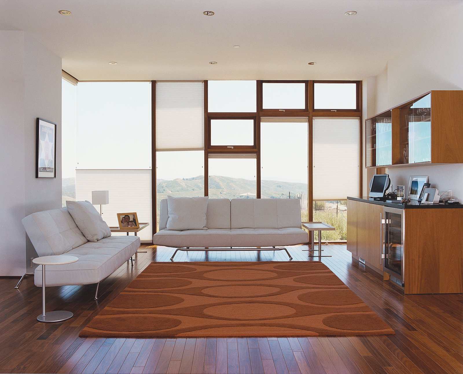 The Shermans' living room is outfitted with Ligne Roset Smala sofas by Pascal Mourgue and a Kenga rug by Angela Adams.  Photo 3 of 5 in Untraditional in Marin