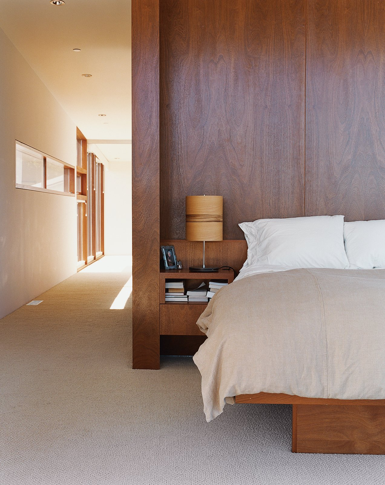 The master bedroom interior is finished with cherry wood. Tagged: Bedroom, Bed, Storage, Table Lighting, and Carpet Floor.  Photo 4 of 5 in Untraditional in Marin