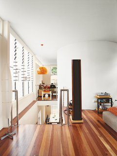 Minimalist Bachelor Pad in Brisbane - Photo 6 of 8 - The black column in his living room is not a mysterious monolith, but one of his speakers.