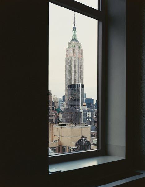 North-facing windows offer views of the Empire State Building and just enough reflected light to keep the sliding wall of aluminum foam glowing.
