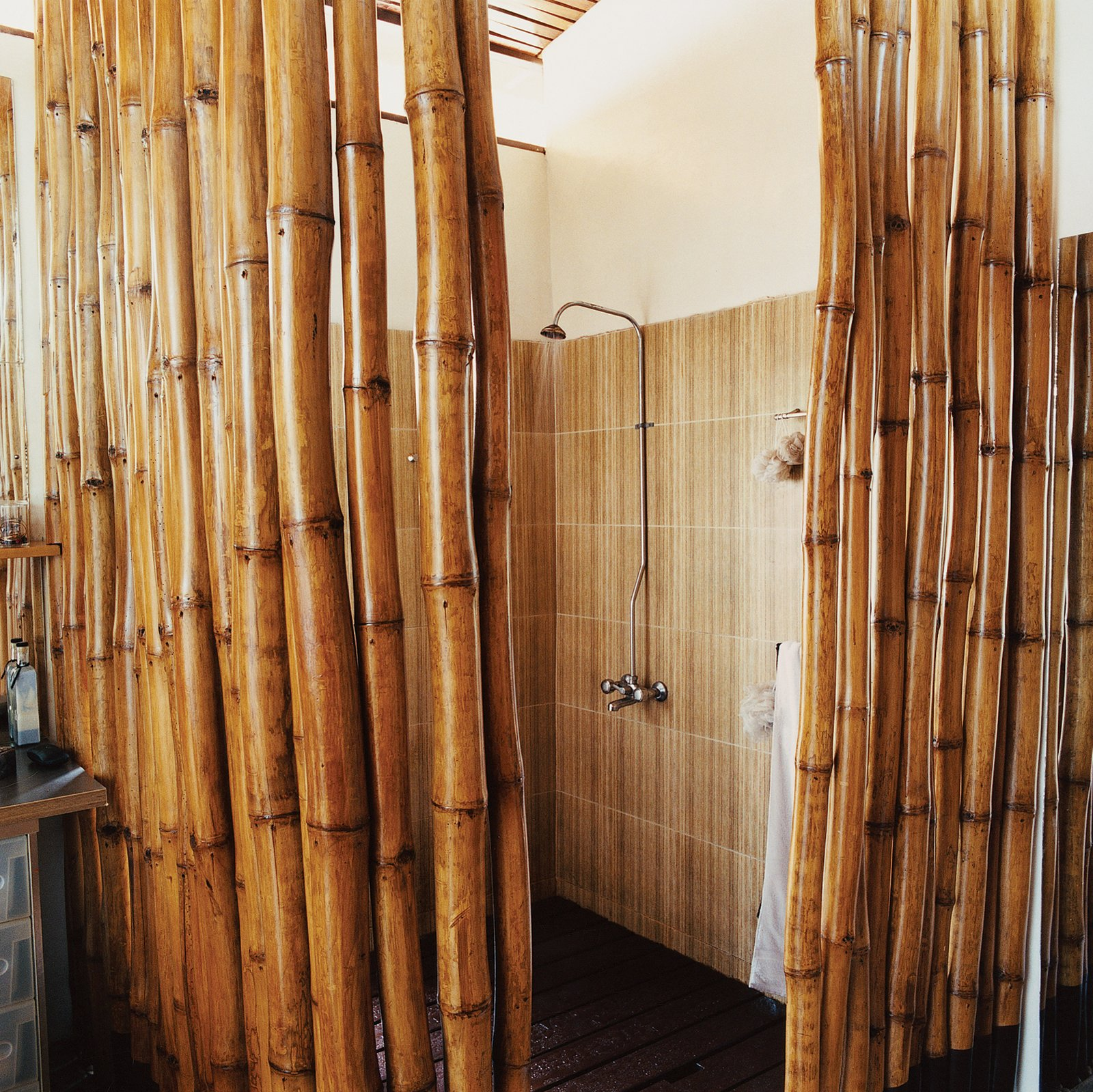 The six-by-six-foot shower boasts a hardwood-slatted deck, which allows water to seep into a concrete pan that empties into the main drainage system. The cage of bamboo poles provides the requisite privacy to the bather.  Photo 3 of 9 in 9 Unusual Modern Bathrooms from An Inno-native Approach