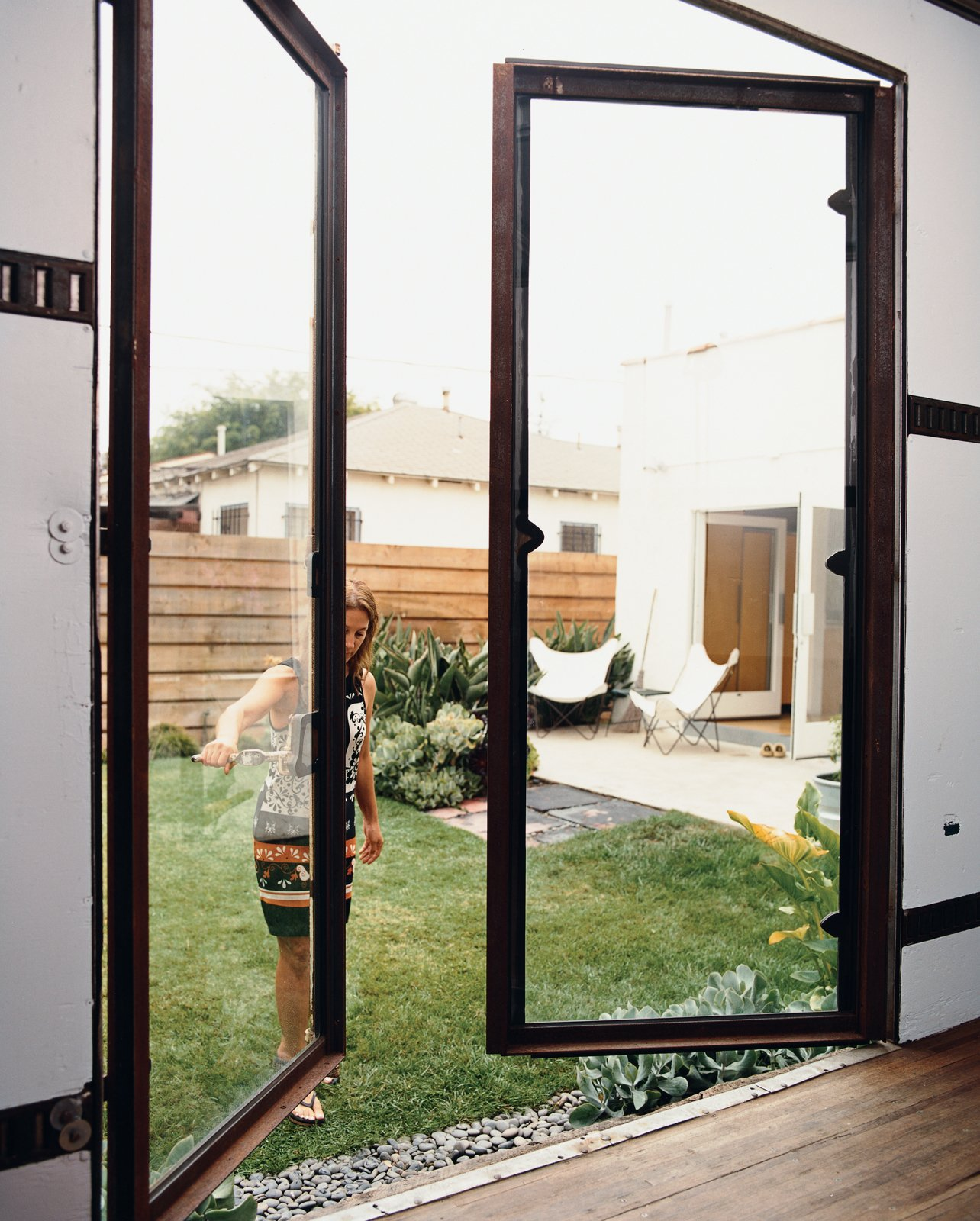 The first phase of rehabbing the backyard trailer was fabricating custom steel-and-glass doors.