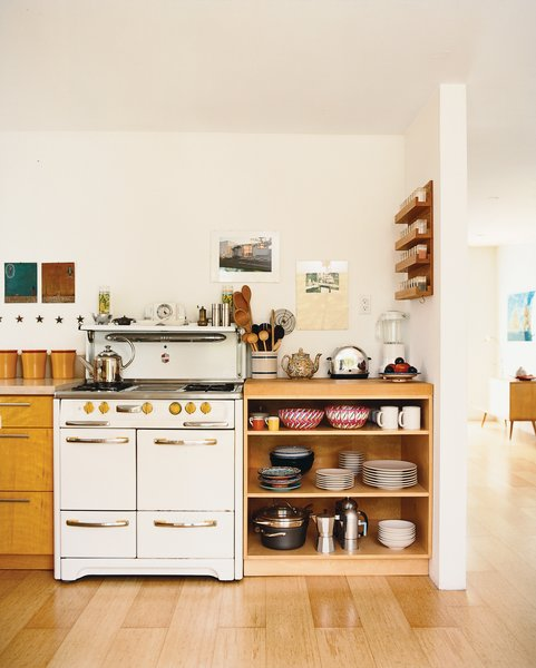 """A lot of the things in here are found objects,"" Siegal says of her home's contents. The vintage stove, with its funky yellow Bakelite knobs, was inherited from the previous owner."
