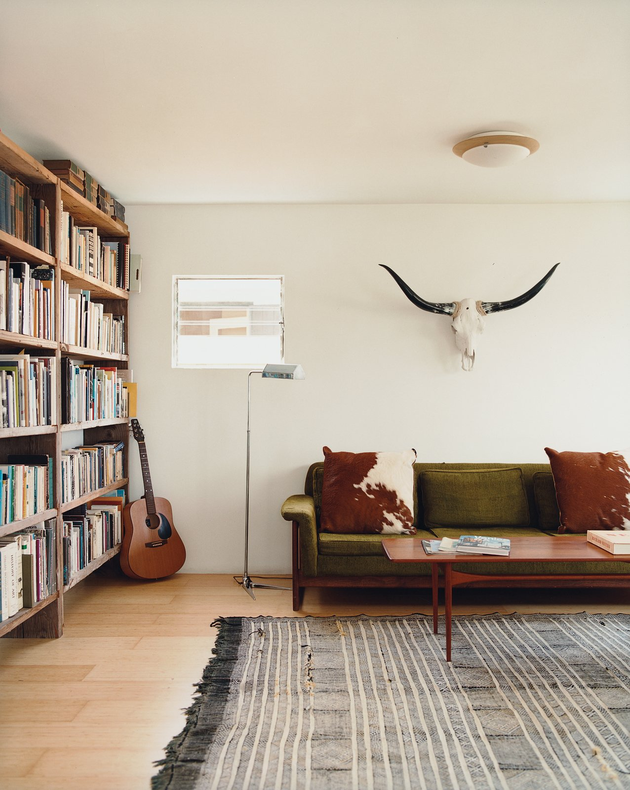 Siegal built bookshelves from scrap wood, bartered for her Danish modern furniture, and haggled for a living-room rug in Morocco. Tagged: Living Room, Light Hardwood Floor, and Sofa.  Photo 5 of 14 in Method Lab