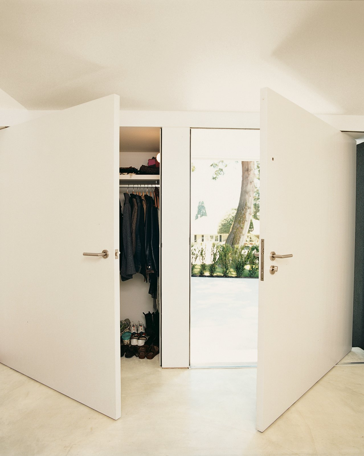 Oversize doors in the front entry create the sense of continuous wall when closed.  Photo 4 of 13 in On the Level