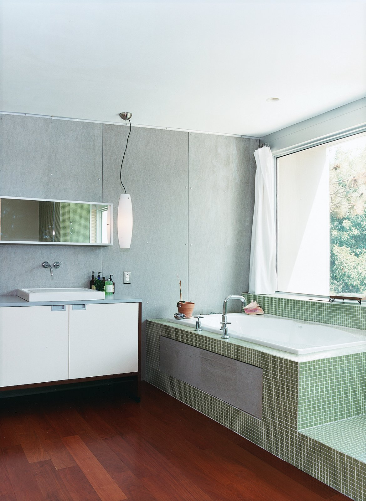The master bathroom, outfitted with Bisazza tiling, has a view of the backyard from the tub.  Photo 7 of 9 in Home Schooled