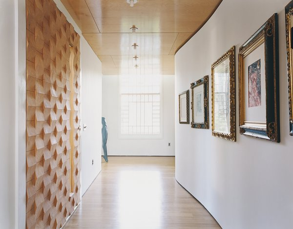The house is as much a work of art as a showcase for it. The Suarezes are catholic in their tastes: They buy for love not investment, their collection a mix of high and low. In the foyer, prints and drawings acquired over the course of their world travels hang along the attenuated S-curve of the wall opposite the front door.