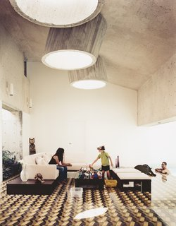 5 Architectural Tricks and Devices to Bring Natural Light Into Your Home - Photo 5 of 12 - Three protruding concrete skylights brighten this living room, despite the graphic floor tile and dark ceiling.