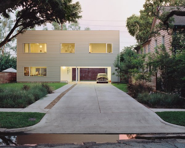 Architects Dawn Finley and Mark Wamble's 1,200-square-foot house in Houston, Texas, is clad in corrugated metal and contains their five-person firm, Interloop—Architecture.
