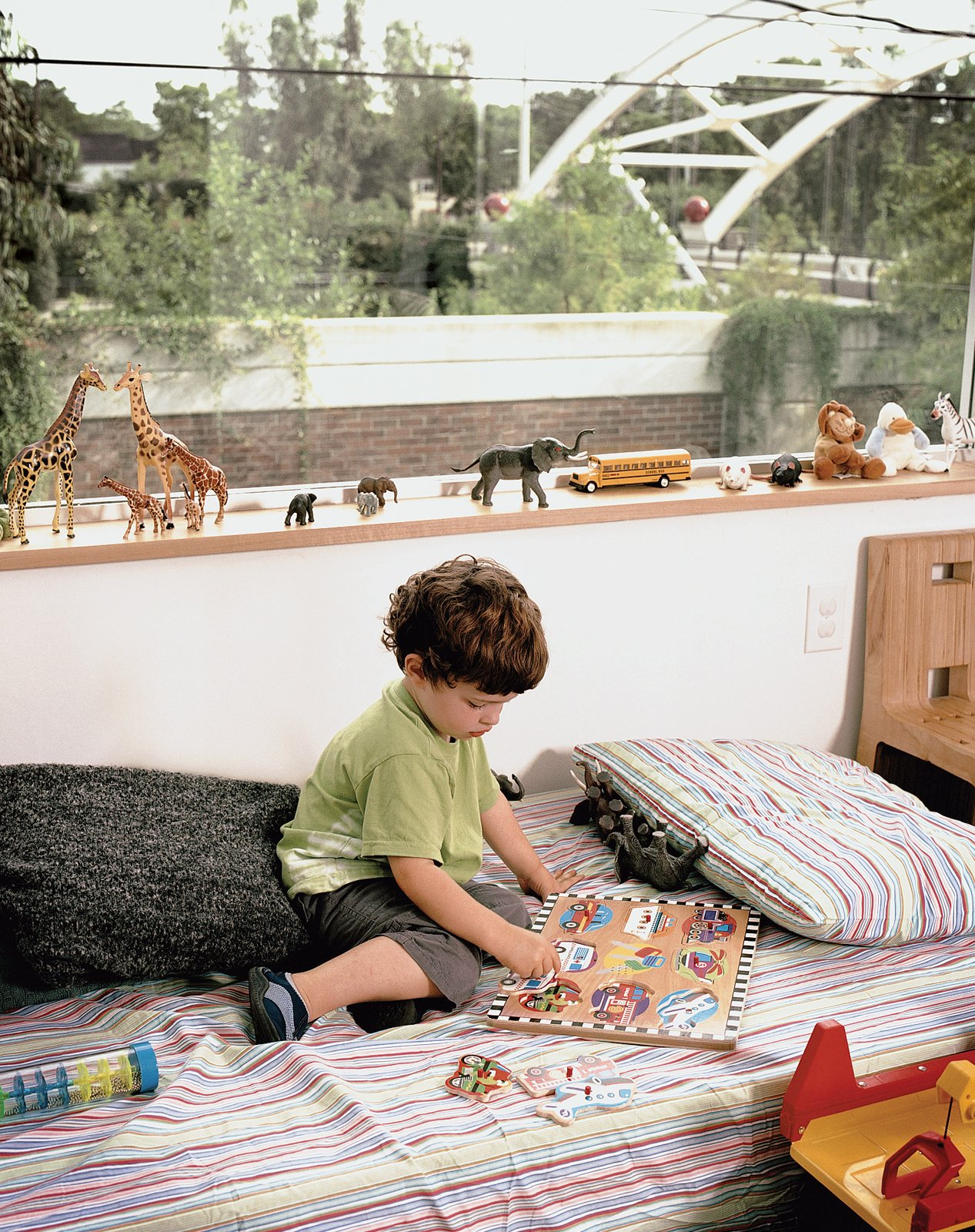 Leroy with his menagerie and the highway-spanning bridge beyond. Tagged: Kids Room and Bedroom.  Photo 6 of 12 in Houston, TX