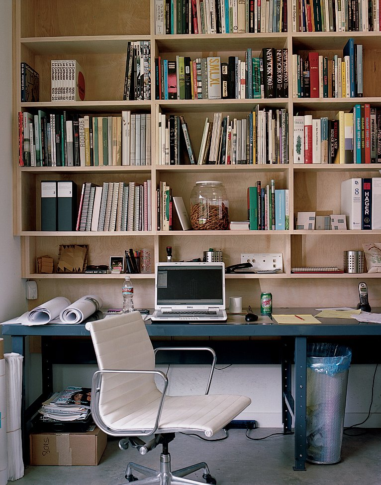 A work station in the couple's office. Tagged: Office, Chair, Bookcase, Shelves, Storage, and Desk.  Photo 7 of 12 in Houston, TX