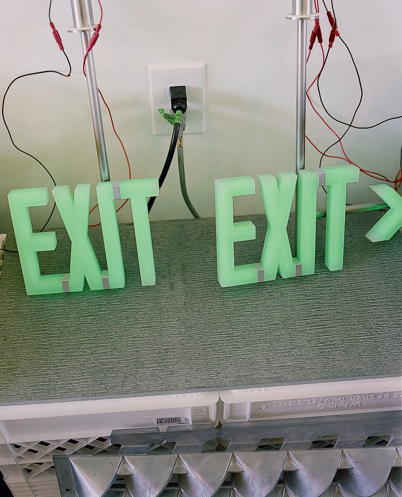Custom exit sign are seen in the office.