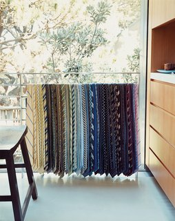 This Surfer's Beach House is More Than It Seems - Photo 9 of 13 - The collection of neck-ties Lloyd-Butler and Zelen have amassed is on permanent display draped over an upstairs railing.