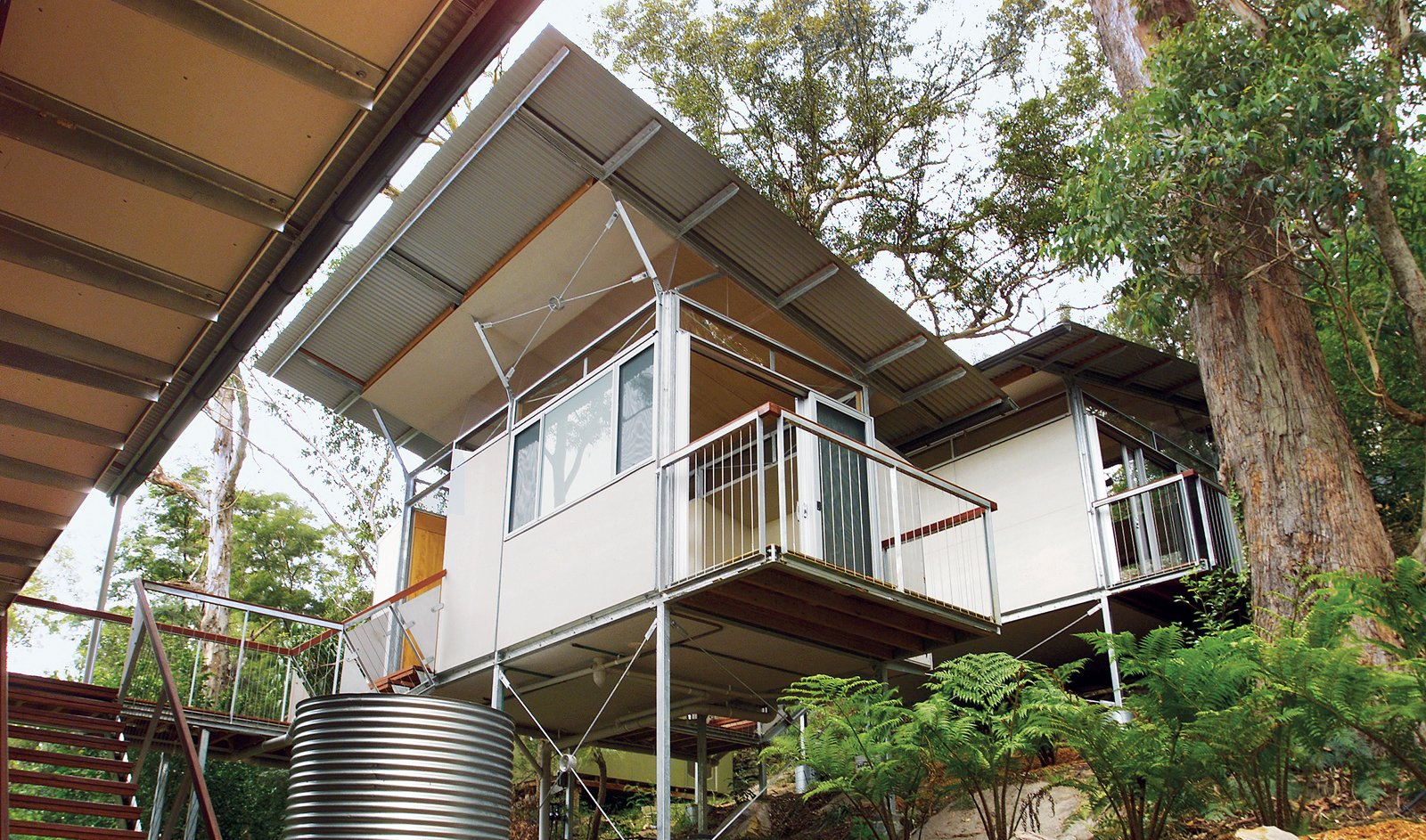 Remote living, especially on an island, requires a fair degree of self-sufficiency. Dangar Island has a limited water supply, so all the roofs on the Flood house were designed to collect rainwater and channel it into a 6,600-gallon tank.  Photo 1 of 4 in Outback Staked House