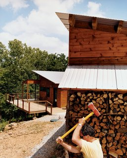 Part of the Plan - Photo 1 of 4 - Berryville, Arkansas, where Jelle Kiesling's vacation house is located, may be the self-proclaimed turkey capital of America, but here he's seen chopping wood—not getting ready for Thanksgiving.