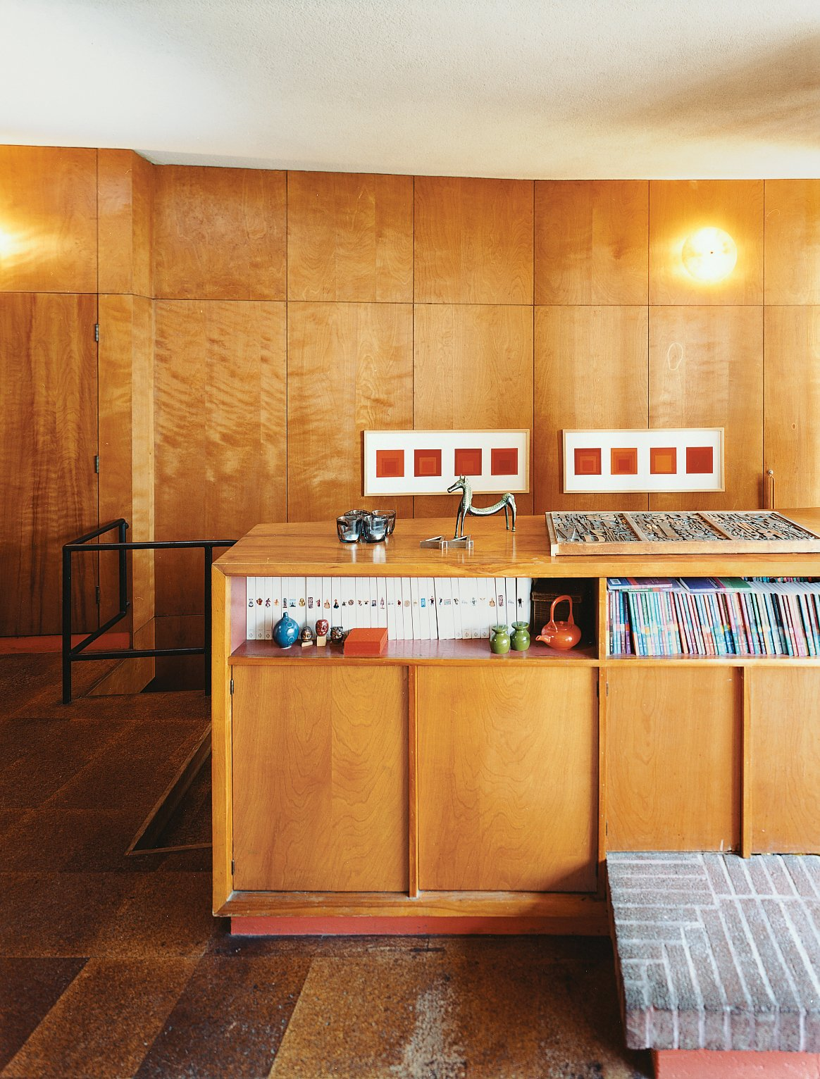 Tidy shelving provides perfect storage for Phaidon's Art and Ideas series. Joseph Albers prints hang in the background. Tagged: Storage Room and Shelves Storage Type.  Photo 7 of 14 in Mid-Century Mash-Up