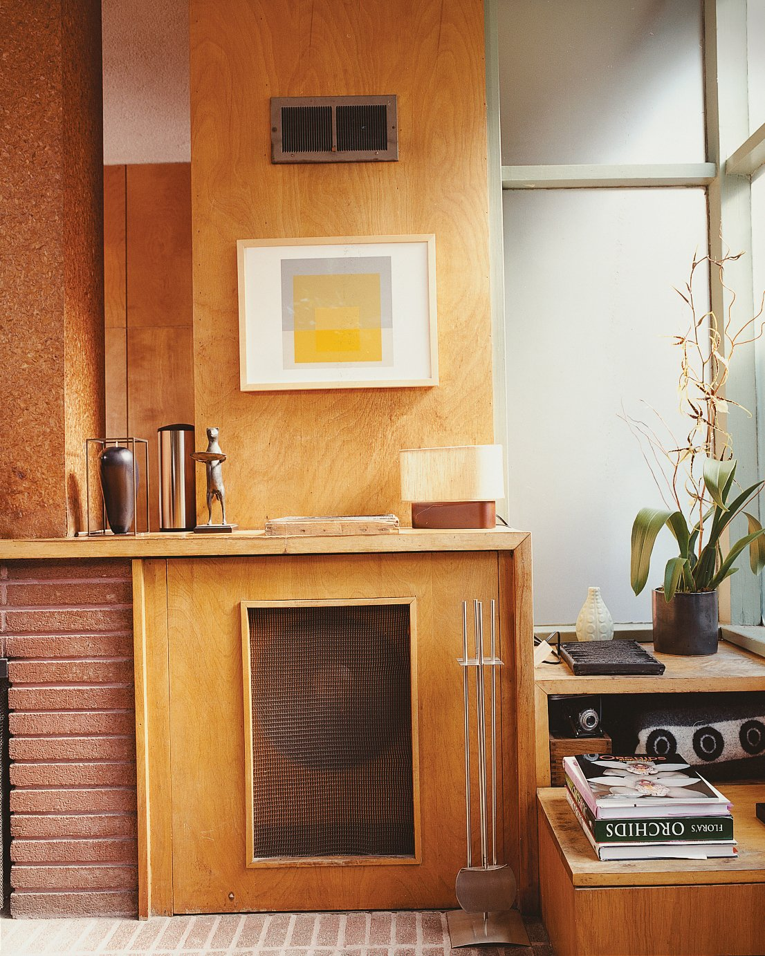 Hill included a hidden turntable and mono speaker cabinet in the original design. Tagged: Living Room.  Photo 9 of 14 in Mid-Century Mash-Up