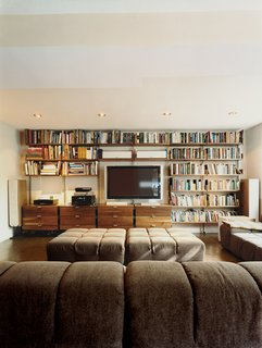 Mid-Century Mash-Up - Photo 12 of 14 - Atlas shelving provides the framework for Farnham's entertainment center. Almost 100 square feet of Patricia Urquiola's Tufty-Time sofa for B&B Italia provides ample space to stretch out.