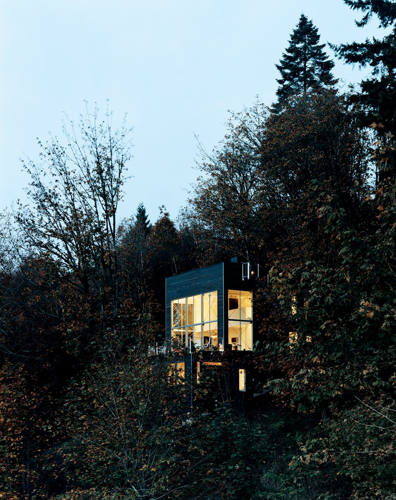 Uninspired by the loft options in downtown Portland, Oregon, the Andréns opted to design and build their own freestanding version in the hills just minutes from the city. Tagged: Exterior, Cabin Building Type, Flat RoofLine, and House.  Photo 1 of 8 in Aloft in the Forest