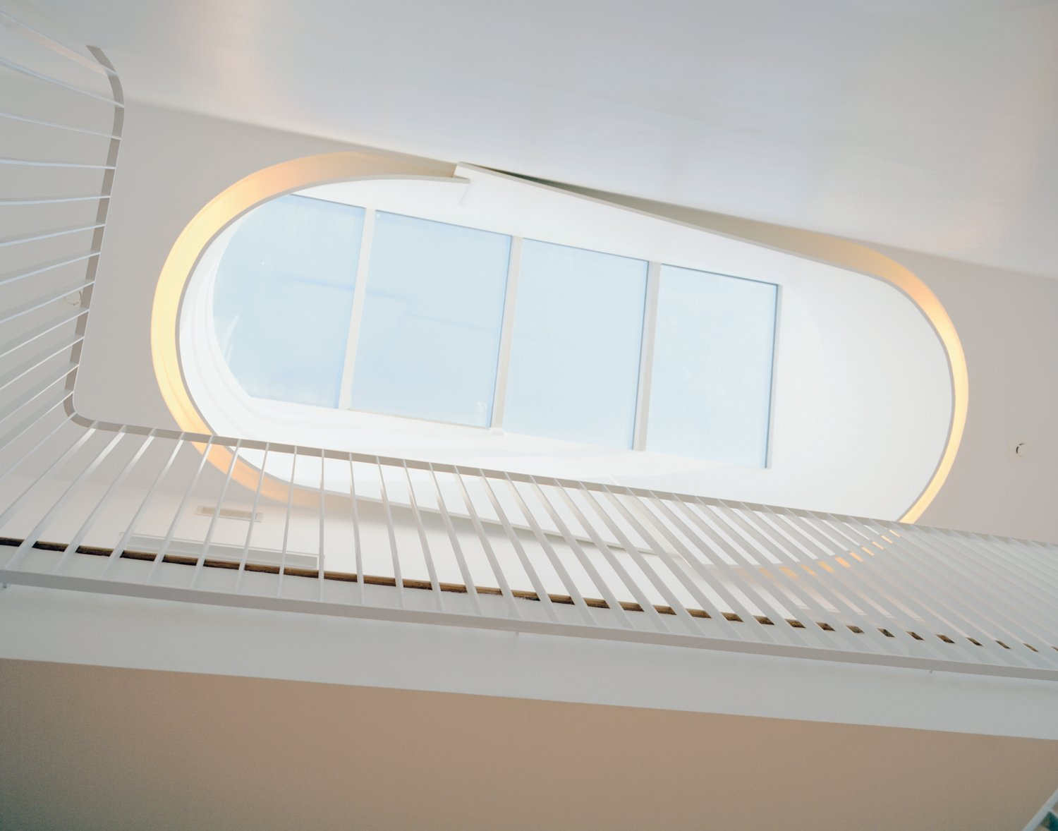 Briggs and Knowles based their design of the oculus on traditional Victorian skylights but tweaked it to fit a more modern sensibility and outfitted it with fluorescent tubing to recreate the effect in the evening. Tagged: Windows and Skylight Window Type.  Photo 2 of 7 in Modern Rowhouse Renovation in New York