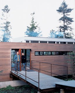 Washington State Vacation Home Sets the Stage - Photo 2 of 4 - Galvanized steel is used to bridge the gap between natural landscape and structure in the entryway of the house.