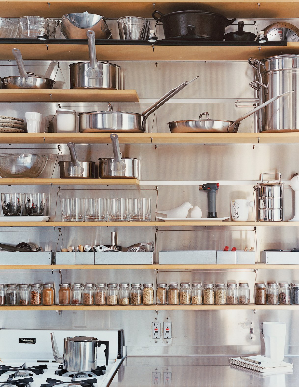 The kitchen shelves are organized with clinical precision. Tagged: Kitchen.  Photo 8 of 11 in Modern Mixed Use in San Diego
