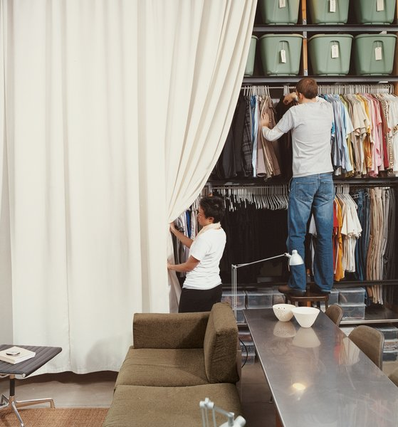 """Local sailboat shops wanted thousands to make the 13-by-13-foot curtain that hides the Wall of Storage. """"We we called my parents in Bangkok, gave them the dimensions, and they got it made for 150 bucks."""" says Im."""