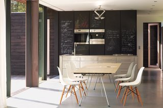 Chalkboard-fronted cabinets provide an ideal surface for scrawling shopping lists.