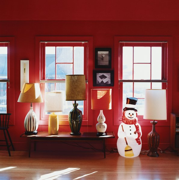 Thrift-store lamps and an illuminated snowman lend the loft a warm glow at night.